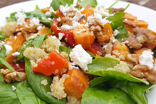 A low-FODMAP salad with roasted sweet potato and red peppers