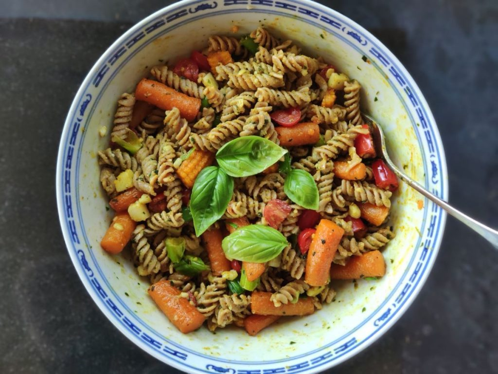 Bowl of pasta salad with roasted vegetables