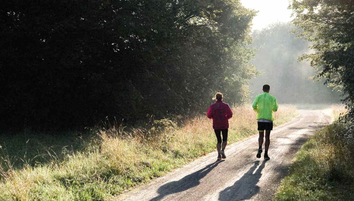 Two people jogging in daytime