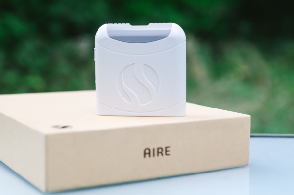 White FoodMarble AIRE device on AIRE box