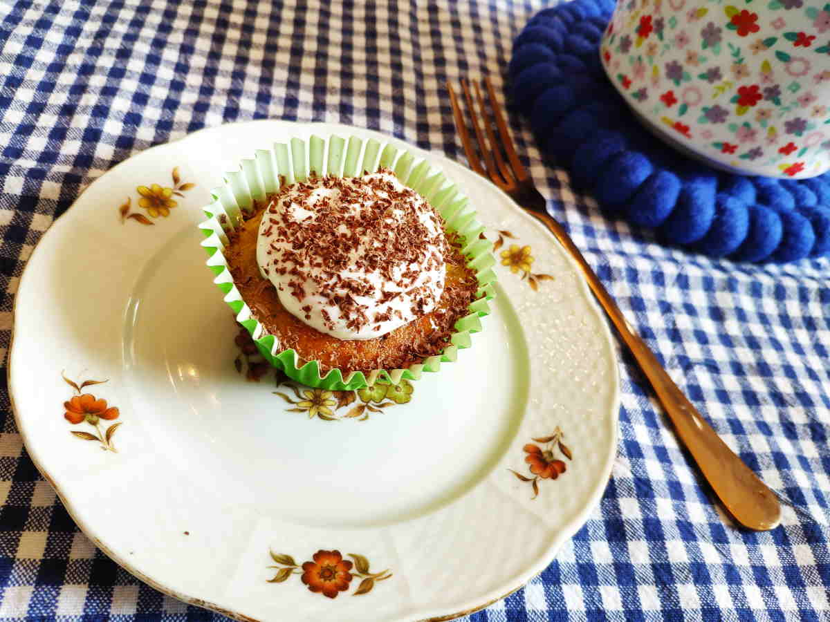 Citrus courgette cupcake with greek yoghurt and grated chocolate topping
