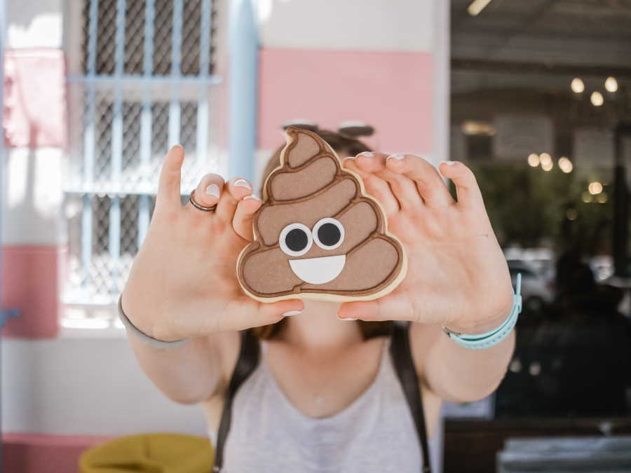 Woman holding poop emoji case to camera