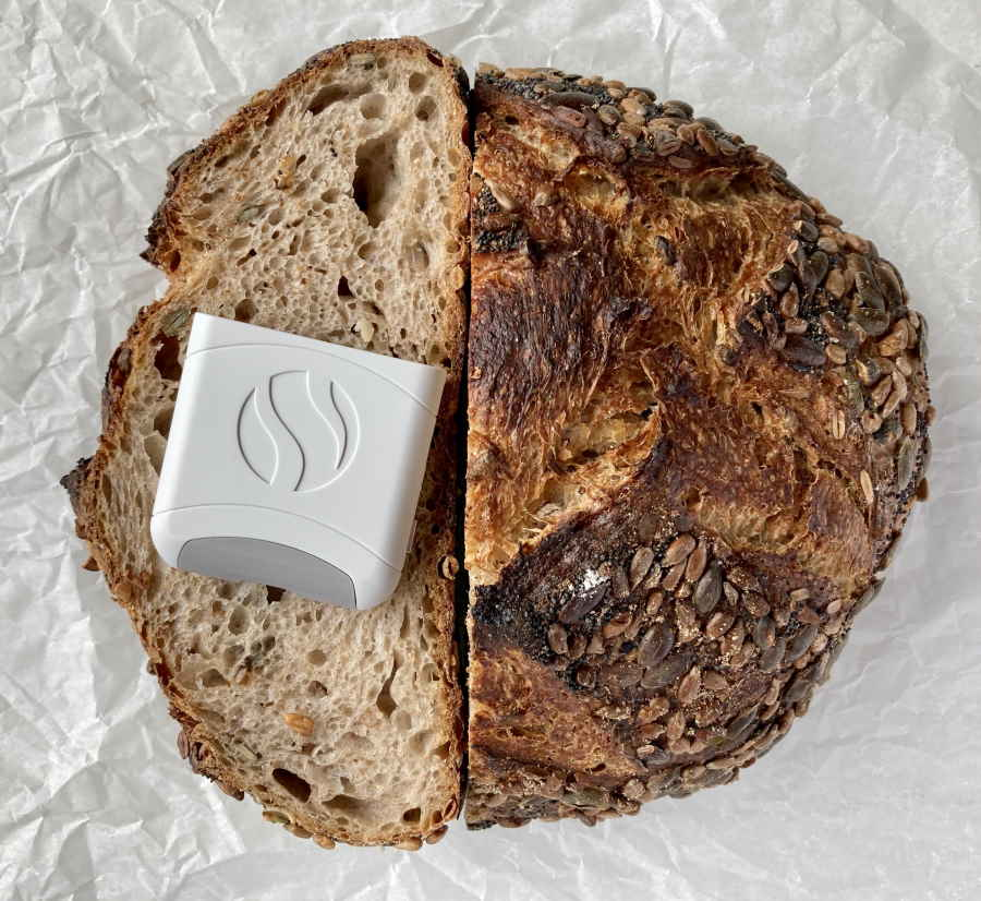 Round sourdough boule and white AIRE device